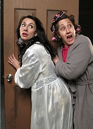 Fearing that it will upset their wedding plans, the cousins of Latshek Boobitshek, played by Nikki Iliopoulou (left) and Debra Zane (right), resist the news that his mother has died.