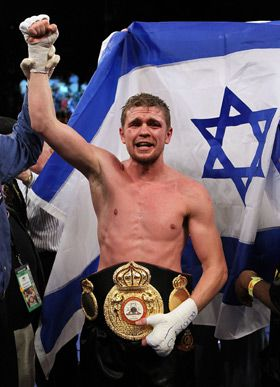 Champ: Yuri Foreman, a rabbi in training, wore his new belt after beating Daniel Santos to claim the World Boxing Association title in Las Vegas.