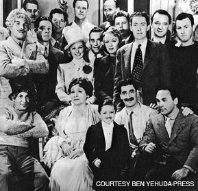 HE RAN AWAY TO JOIN THE CIRGUS: Irving Brecher (the polka dot tie with his hand on Groucho?s shoulder) with the cast of 'At the Circus'.