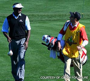 DREAM COME TRUE: Michael Brown (right) got the chance to caddy for golfer Vijay Singh after winning an auction on caddyforacure.com.