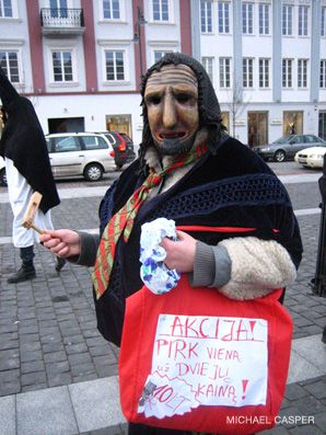 Funny, You Don't Look Jewish: A reveler during the Lithuanian capital's pre-Lent celebration dressed as a 'Jew.'