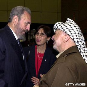 FIRST TIME AROUND: Fidel Castro, left, and Yasser Arafat talk in 2001 at the first United Nations racism conference in Durban, South Africa.
