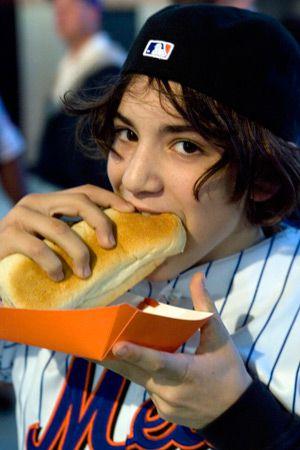 Chin Music: Mets fan Yehuda Bloom bites into a hot dog at Citi Field.