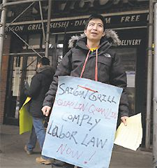 Struggle: Pickets at a Vietnamese restaurant in Manhattan.