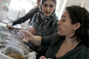 Co-authors Maggie Schmitt (right) and Laila El-Haddad (left) prepare the traditional Gazan dish maftoul.