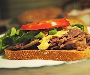 Corned beef sandwich with mustard.