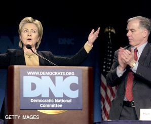 OPEN ARMS: DNC Chairman Howard Dean, seen here with presidential contender Hillary Clinton, ?needs to be slapped around a bit,? according to one prominent Jewish donor.