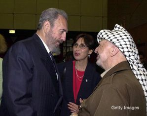 Durban I: The 2001 conference came under fire for providing cover for antisemitic and anti-Israel activity. Above, Cuban leader Fidel Castro confers with late PLO Chairman Yasser Arafat during the conference.