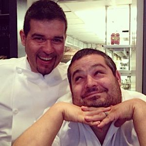 Chefs Roberto Trevino and Eric Greenspan goofing around in the kitchen.
