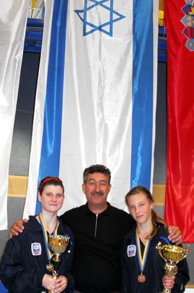 Improvised: Israeli fencers Strelnikov, left, Kornarov, right, and their coach sang the ?Hatikvah? at the European Cup in Austria.