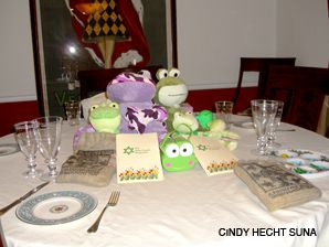 NO LONGER A PLAGUE: The hopping balls of slime God sent to torment the Egyptians have a place of honor at this Passover table.