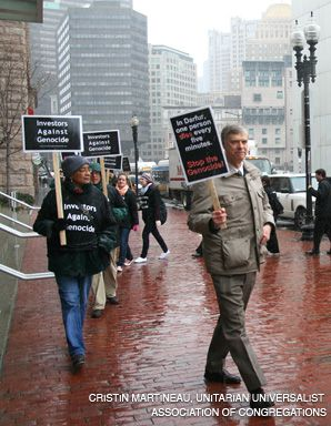 TAKING A STAND: Bill Rosenfeld, center, and members of Investors Against Genocide march outside a Fidelity shareholders meeting earlier this year.