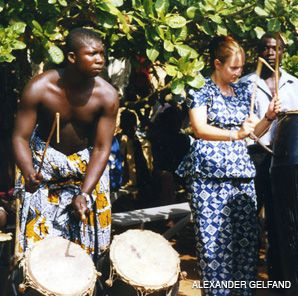 THE BEAT GOES ON: The author?s wife, Ingrid Gordon, drummed in a ritual celebration at the palace of a Ghanaian chief.