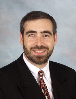 Hired: After his start-up fold- ed, Rabbi Avi Greene found a job as a day school principal.