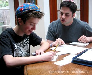 Lights, Camera, Torah: Todd Shotz founded Hebrew Helpers in 2004, and hopes this year to expand beyond Los Angeles. Above, Shotz (right) tutors acting coach Caitlin Adams's son Gabriel on his bar mitzvah lesson.