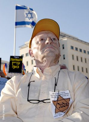 Holocaust survivors wore yellow Stars of David and striped pajamas earlier this month to protest the amount of aid they are receiving from the Israeli government