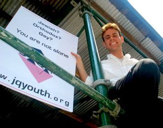 We?re Here: Levovitz holds up a JQY sign.