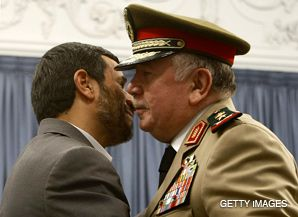 DAMAGE CONTROL: Iranian President Mahmoud Ahmadinejad (left) embraces Syrian Defense Minister Hassan Turkmani prior to a May 26 meeting.