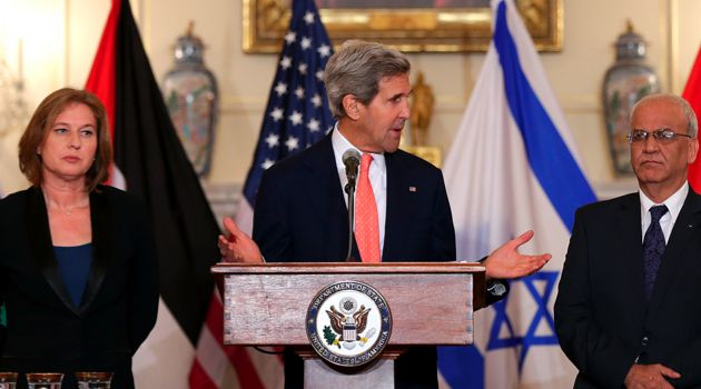 Israeli Minister of Justice Tzipi Livni stands with U.S. Secretary of State John Kerry and Palestinian negotiator Saeb Erekat.