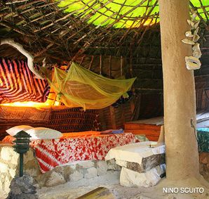 ANTI-RESORT: Great Huts, near Port Antonio, Jamaica, embraces a more authentic island culture. Guests stay in huts and tented rooms built of local materials.