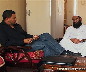 STRUGGLE: Imam Muhsin Hendricks, left, an openly gay Muslim, confronts Mufti A.K. Hoosen in a scene from ?Jihad for Love.? The documentary depicts gay Muslims waging jihad ? inner struggle ? to reconcile faith and sexual identity.
