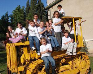 Future Kibbutzniks: Children play on farm equipment at Degania Aleph, Israel?s first kibbutz, which was founded 100 years ago.