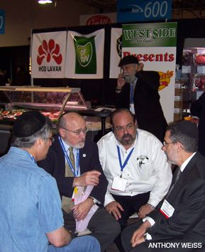 DISASTER PLANNING: Officials from kosher meat companies and kosher certifiers confer about meat supply during Kosherfest 2008.