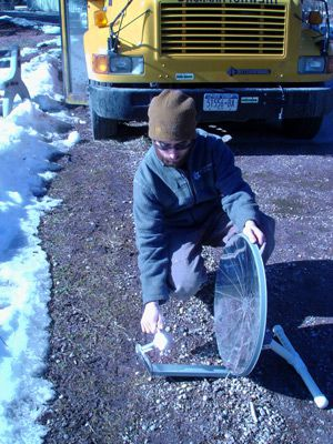 Hot, hot, hot: A Teva Learning Center volunteer uses the sun?s power to roast a marshmallow on a snowy day.