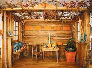 Woodwork: An interior view of Emmett Leader?s sukkah, which cel- ebrates the centennial of organized Judiasm in Bennington, Vt. Below, Tzedakah Box (Birds) 2008.