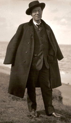 **In A Cloak And A Smile*: Mahler walking at the beach, 1906.