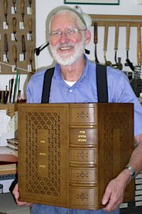 Book Art: Yehuda Miklaf with one of his treasured hand-crafted books.