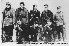 Fighters of the Otriad: Tuvia Bielski (second from right at the back) and six of his group in the Parczow forest, 1943.