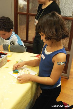 ARTS AND CRAFTS: Josie made ?stained glass windows? at the Museum at Eldridge Street?s Preservation Detectives kids? program.