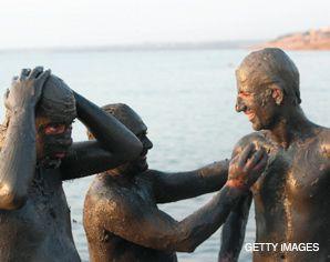 Dead Sea: Swimmers enjoy mud baths off the coast of Shuneh.
