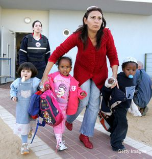 Running for Cover: In Sderot, where rocket fire from the Gaza Strip is a fact of everyday life, residents are often forced to improvise. Above, a school is evacuated during a recent attack.
