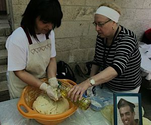 Personal Challah Recipe: Dalia Emanuelof, mother of Dvir Emanuelof whose picture appears framed on the table, makes challah with Bette Brottman of East Windsor, New Jersey.