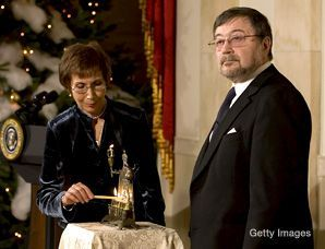 BURNED INTO MEMORY: The parents of murdered reporter Daniel Pearl, Judea and Ruth, lit their family menorah at the White House December 10, part of a day long celebration of Hanukkah by President Bush.