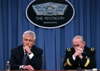 Secretary of Defense Chuck Hagel and Chairman of the Joint Chiefs of Staff Gen. Martin E. Dempsey listen to questions during a media briefing at the Pentagon on May 17. Secretary Hagel spoke about sexual assault in the military.