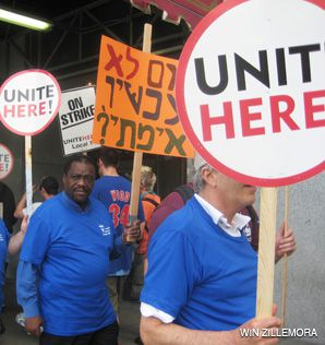 SAY WHAT?: A protest in Chicago included placards in Hebrew (above) and Yiddish.