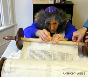 HOLY ROLLER: Pulpit rabbi and scribe Linda Motzkin repairs a Torah scroll.