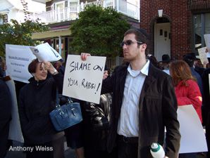 RALLY: Roughly 30 people attended the protest on Saturday outside the Brooklyn home of Rabbi Shlomo Blumenkrantz