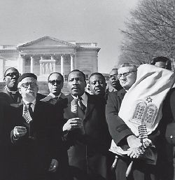 In the Fight: Abraham Joshua Heschel (center left) joins with Martin Luther King in 1968, at one of many joint appearances.