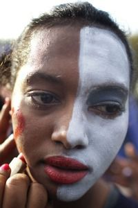 Facing Racism: Ethiopian woman has her face painted for rally against racism.