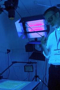 Ultraviolet and Ancient: Scientist Ben Outhwaite uses ultraviolet camera to take images of fragments from genizah.
