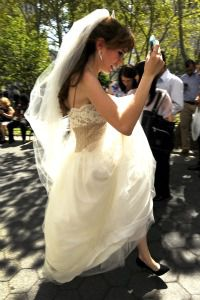 Scrambling on Big Day: A bride scrambles for cover in lower Manhattan after an earthquake rattled the East Coast.
