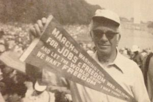 Proud Participant: Hyman Bookbinder shows off a commemorative pennant.