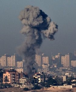 Plumes of smoke rise from Gaza after Israeli warplanes strike.