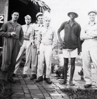 World at War: Lt. Philip Weiner, center, in the Canary Islands with members of his flight crew.