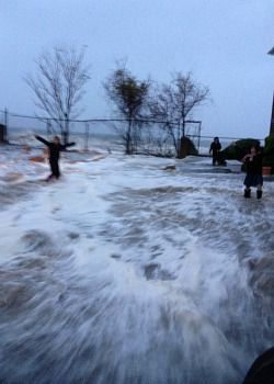 Panicked residents flee Sandy?s rapidly rising floodwaters.