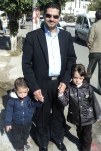 Zafer Al-Rimawi, a Ramallah economist, and his children.